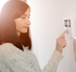 Woman Using Alarm System